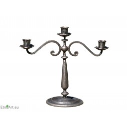 Candlestick With Three CandlesCandlesticks on the table